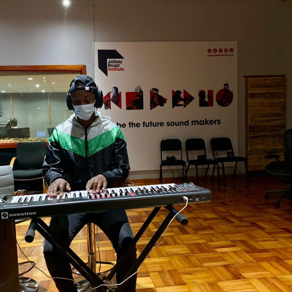 Abbey Road Institute Sound engineering Students playing keyboard in studio in live room