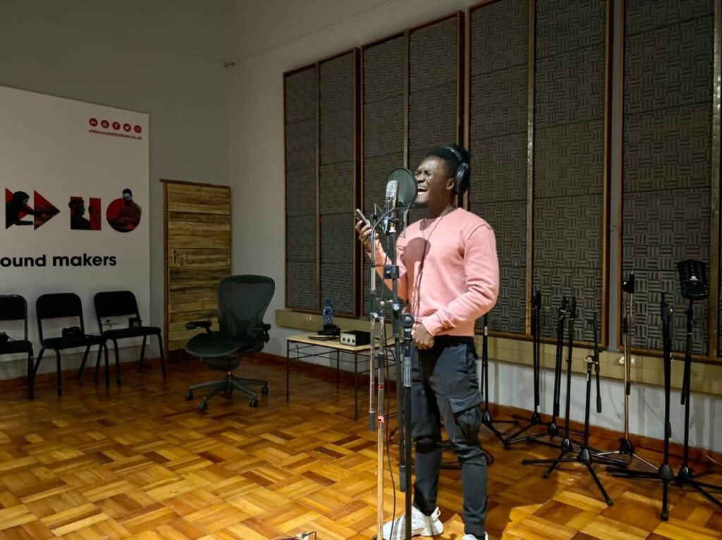 Abbey Road Institute Sound engineering Students singing in studio in live room