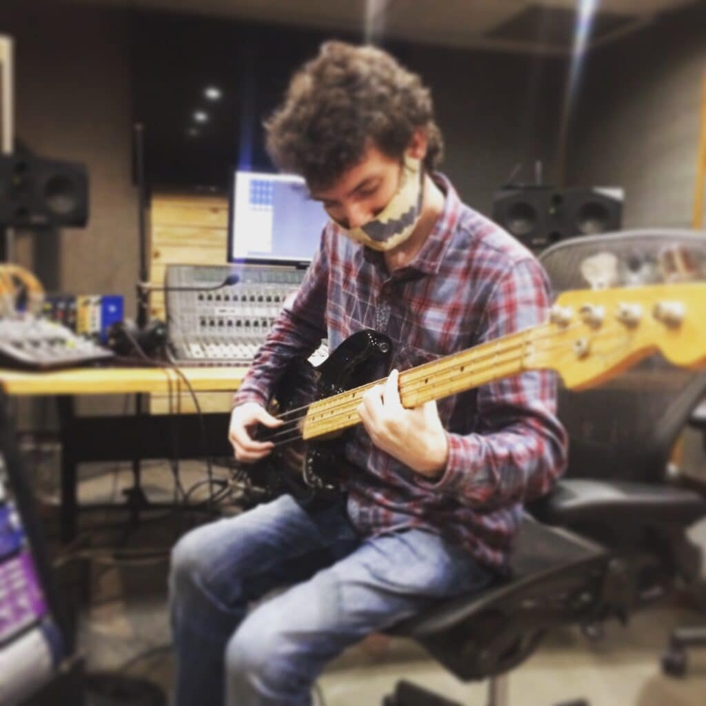 Abbey Road Institute Sound engineering Student playing guitar in studio in live room